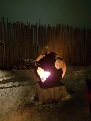 Firepit in shape of the world, round with cut outs of the continents