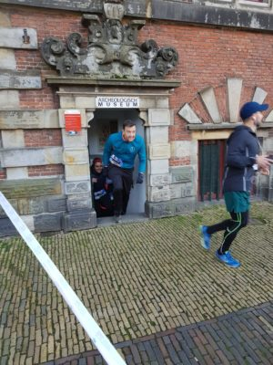 Runners emerging from subterranean Archeological Museum Haarlem during Urban Trail run around the city.